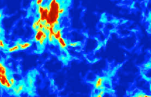 Un modèle d'ondes radio dans le ciel créé par la combinaison du rayonnement des premières étoiles et de l'effet de la matière noire. Les zones bleues sont celles où la matière noire a refroidi la matière habituelle (Credit : Pr Rennan Barkana)