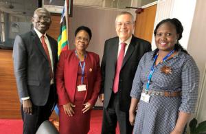 Mrs. Ntitiri Pascasia (Passy) Washeba, Dr. Peter Ngategize, Mrs. Dorcus Otim, with Joseph Shevel, GIMI President
