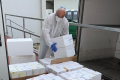 Prof. Robert Fluhr, director of the Nancy and Stephen Grand Israel National Center for Personalized Medicine at the Weizmann Institute of Science, receives the first shipment of tests arriving at the Weizmann Institute